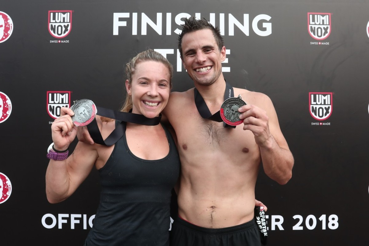 Husband and wife Brendan and Jade Hunt from Australia, winners of the 8km men's and women's elite race, in the Spartan Race Hong Kong Sprint at Tin Shui Wai. Photos: Jonathan Wong