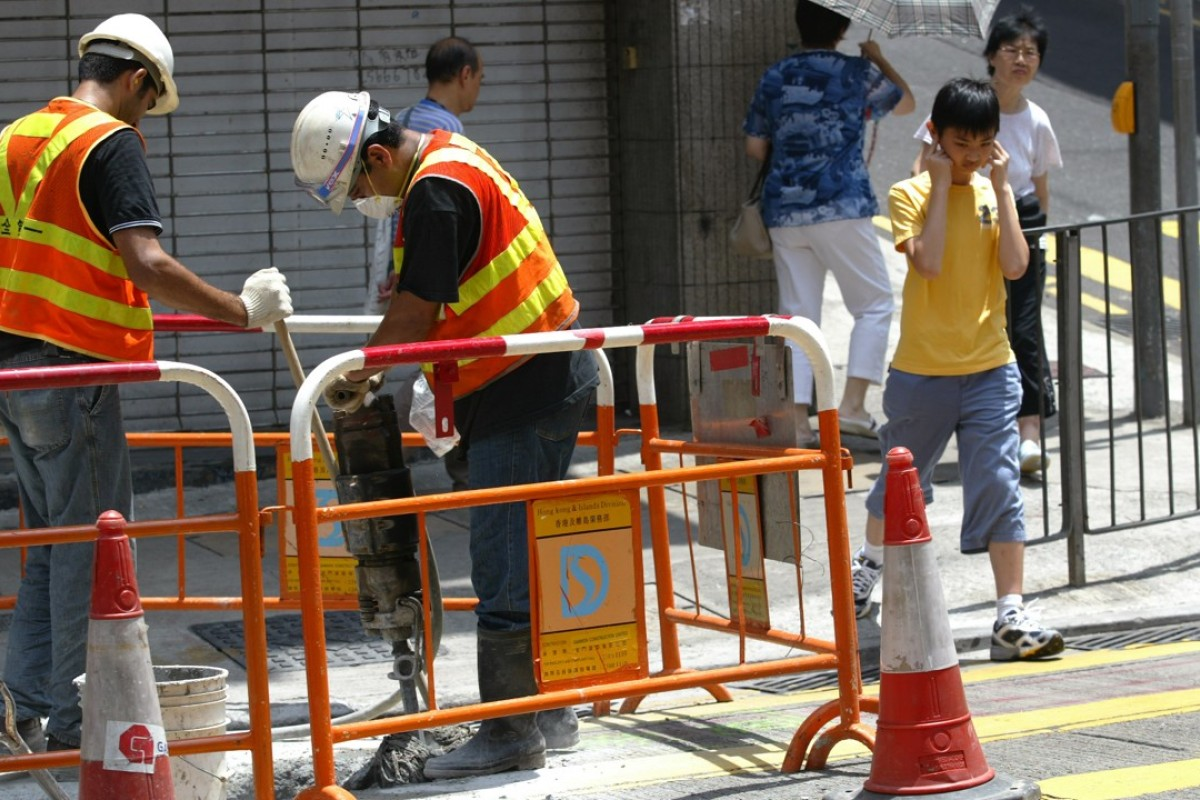 Construction workers with a jackhammer in Hong Kong.