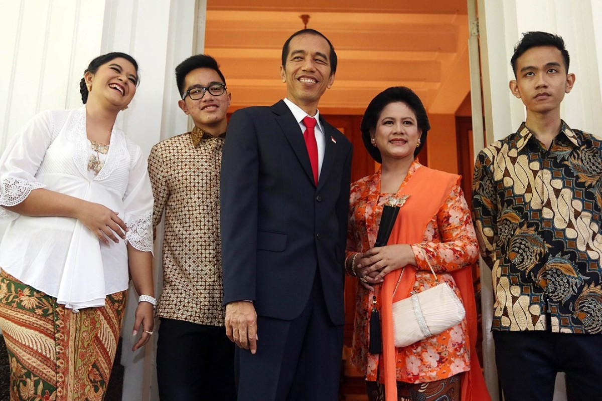 Indonesia's President Joko Widodo and family. With key electoral tests looming, Widodo has little incentive to meddle with what is proving to be a popular healthcare scheme. Photo: AFP