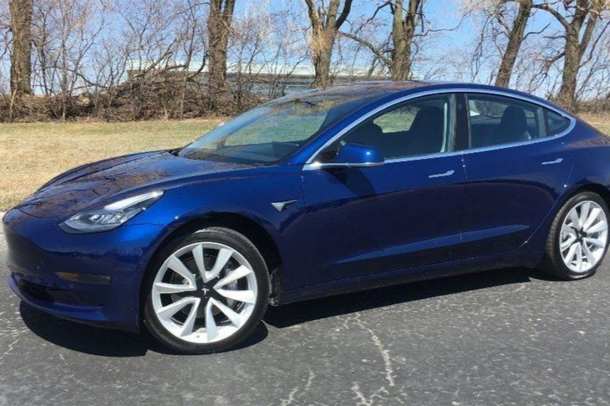 The Tesla Model 3 – in deep-blue metallic paint with 19-inch (48-centimetre) wheels – is the best 'affordable' electric vehicle on the market. Photo: Chicago Tribune