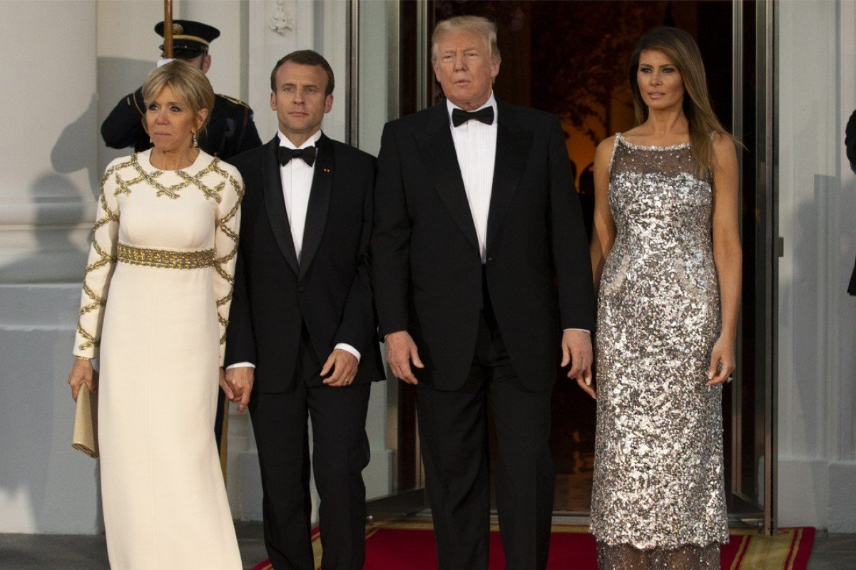 US First Lady Melania Trump, (far right), dressed in a Chanel gown, stands beside her husband, US President Donald Trump, with French President Emmanuel Macron (second left) and Brigitte Macron, France's first lady, as the Trumps host their first state visit at the White House on Tuesday. Photo: Bloomberg