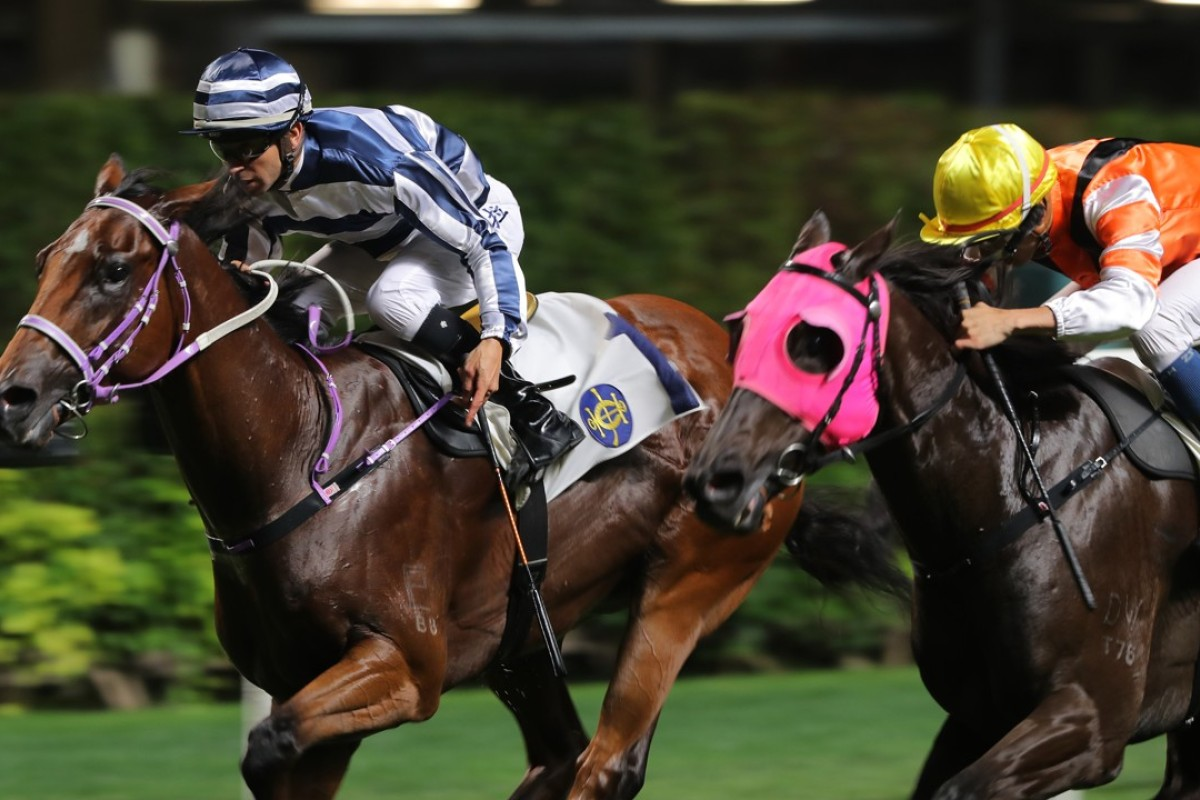Joao Moreira pushes out Eighty Eighty to victory on Wednesday night. Photo: Kenneth Chan