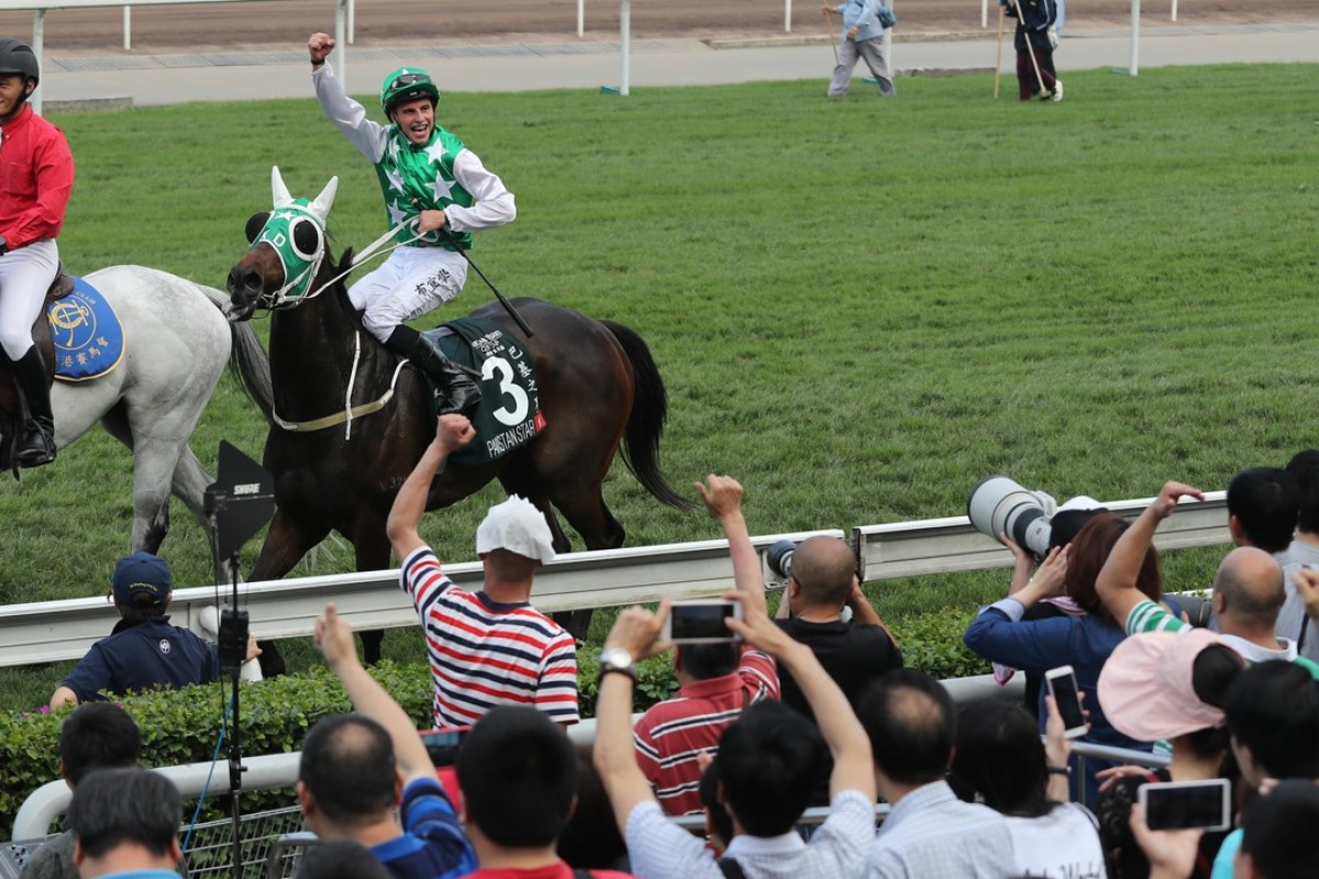 Jockey William Buick celebrates Pakistan Star's win with the fans. Photos: Kenneth Chan