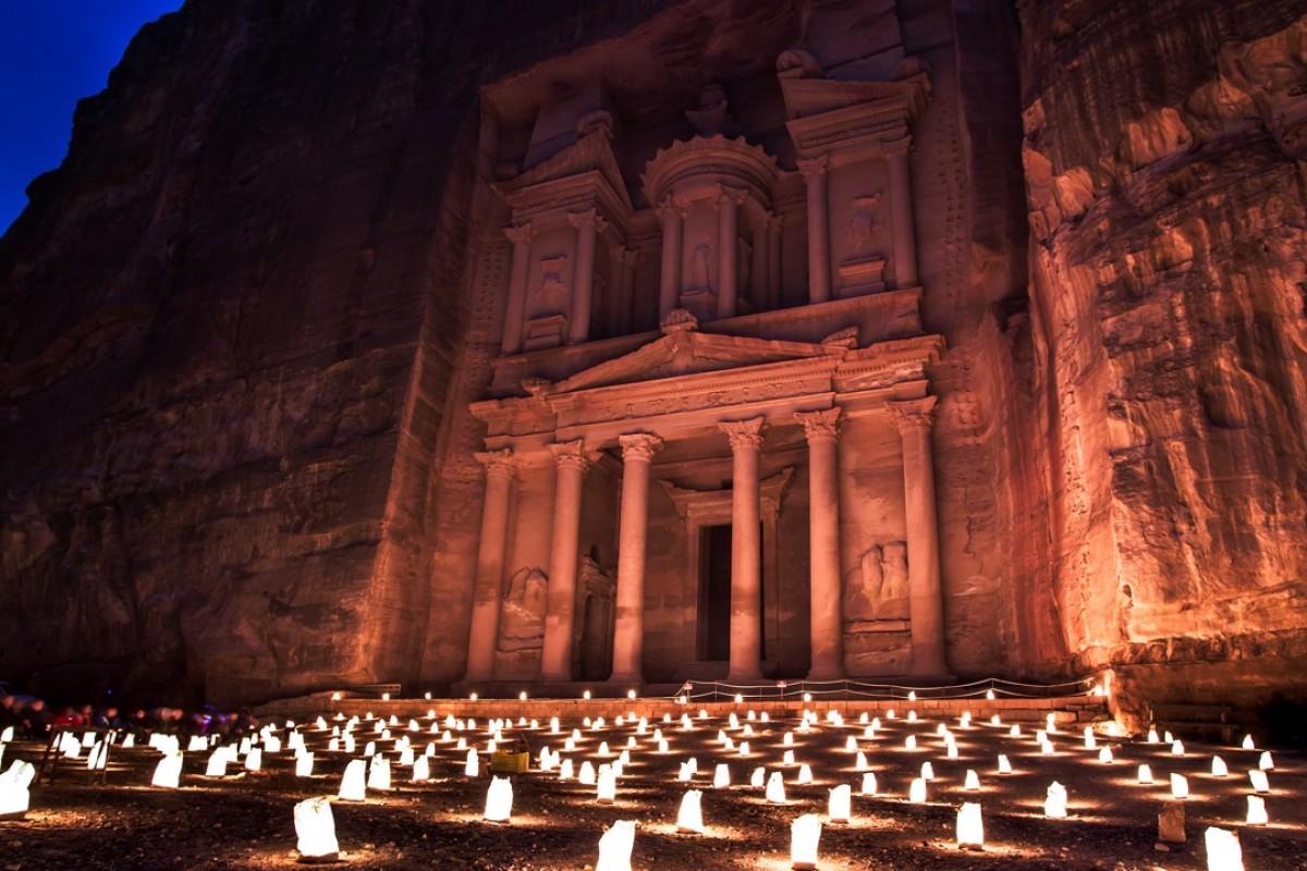 The Petra by Night show illuminates the Treasury with candlelight, in Petra, Jordan.