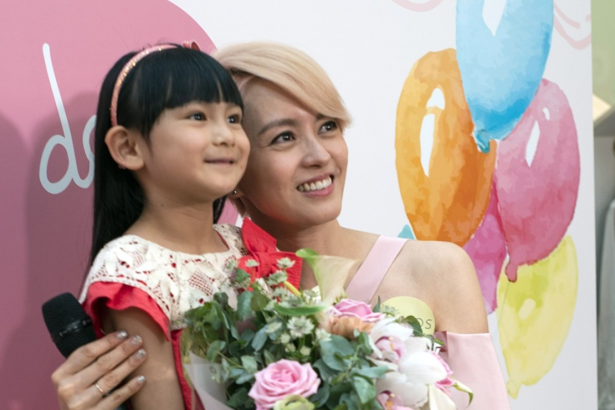Hong Kong singer and actress Gigi Leung (right) pictured with a child at the Nanos store opening in Harbour City, Tsim Sha Tsui, on Mother's Day.