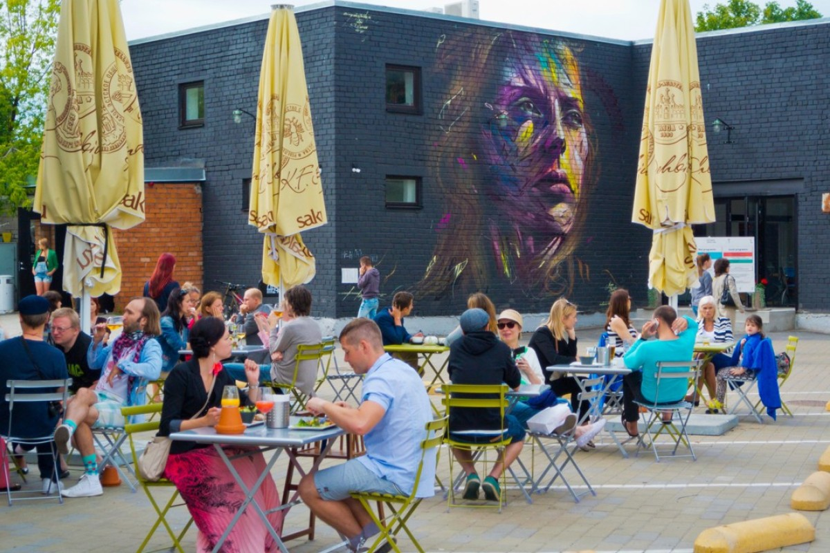 Digital nomads enjoy the terrace at Telliskivi Creative City, in Tallinn, Estonia. Picture: Alamy
