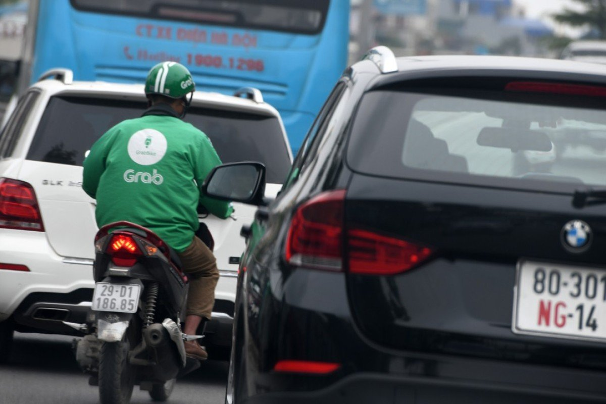 A Grab driver in Hanoi, where regulators have launched an antitrust investigation into the company. Photo: AFP
