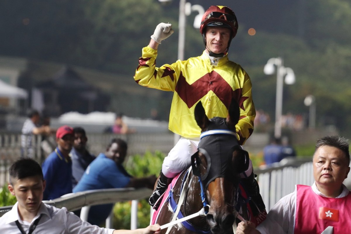 Zac Purton celebrates his Kranji Mile victory with Southern Legend. Photos: Kenneth Chan