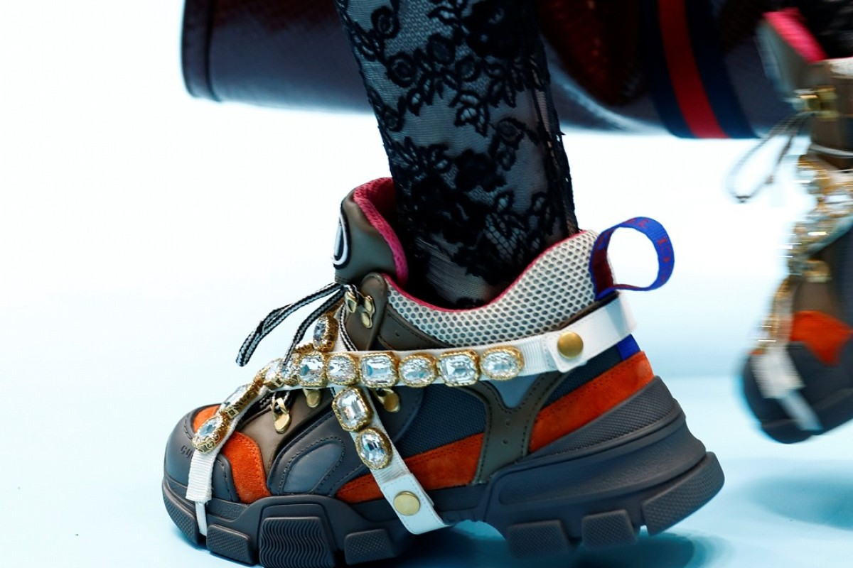 A Gucci model wears diamante attachments to her shoes on the runway during a show for the Italian fashion house, which says it will pay homage to France by showing his next spring/summer collection in Paris, instead of its usual home in Milan. Photo: Reuters