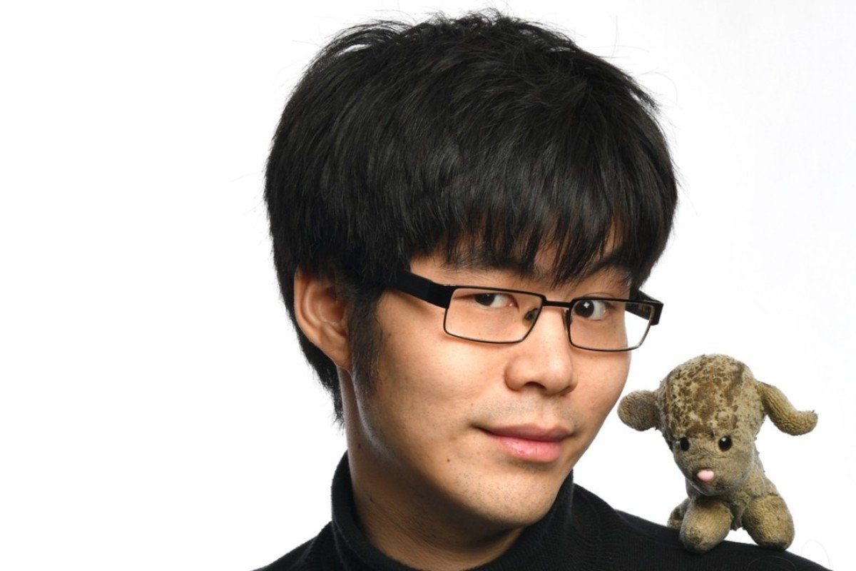 Ken Cheng with one of his toy lambs. Picture: courtesy of Ken Cheng