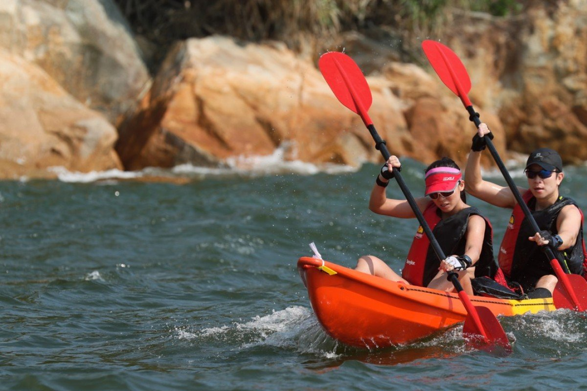 Kayak 'n' Run competitors in action on the water. Photo: Action Asia Event