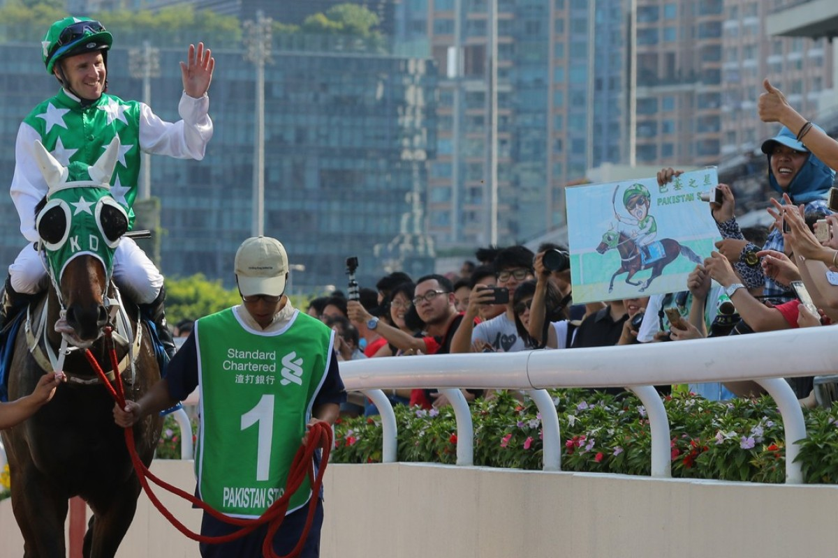 Tommy Berry returns to the scales after winning the Group One Champions & Chater Cup with Pakistan Star. Photos: Kenneth Chan
