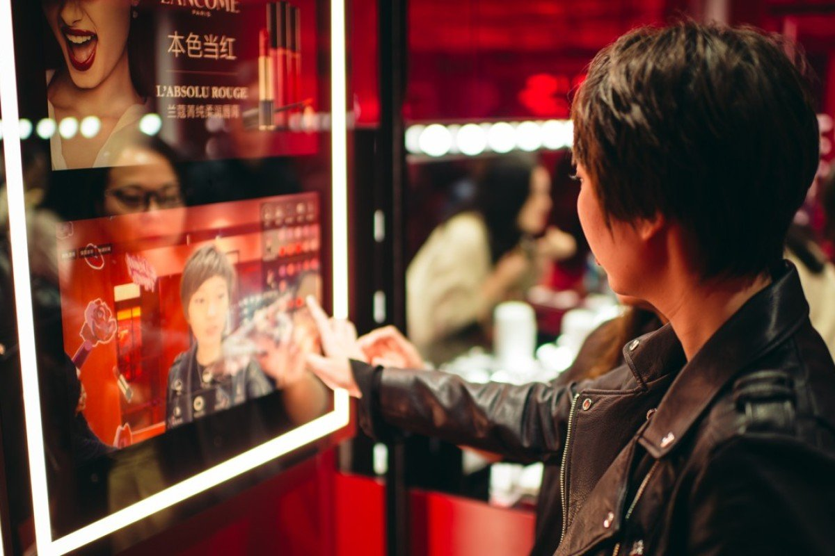 A customer tests make-up virtually via TMall's Luxury Pavilion.