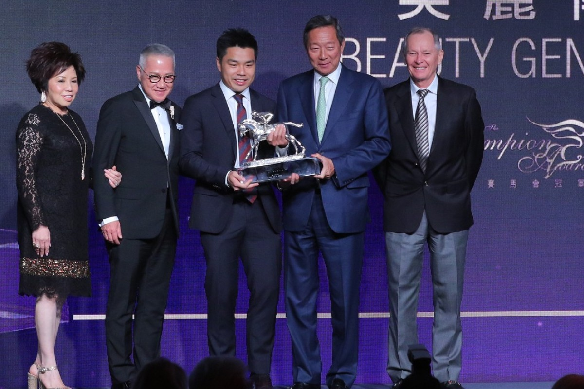 Trainer John Moore (far right) with HKJC chairman Simon Ip and the owners of Horse of the Year, Beauty Generation, at the Champion Awards presentation. Photo: Kenneth Chan