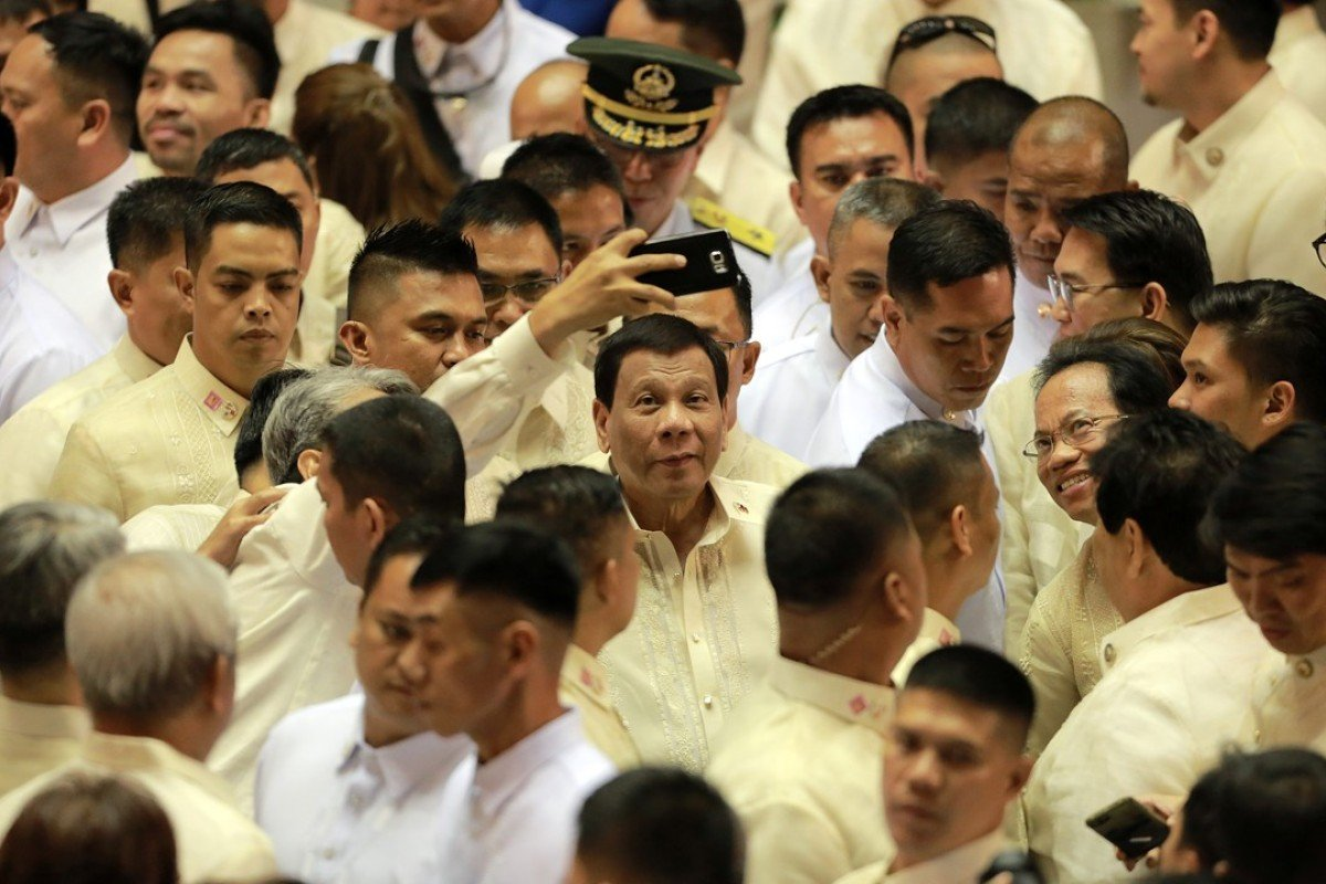 Philippine President Rodrigo Duterte, cetnre, is seen after delivering his third State of the Nation Address. Photo: Xinhua