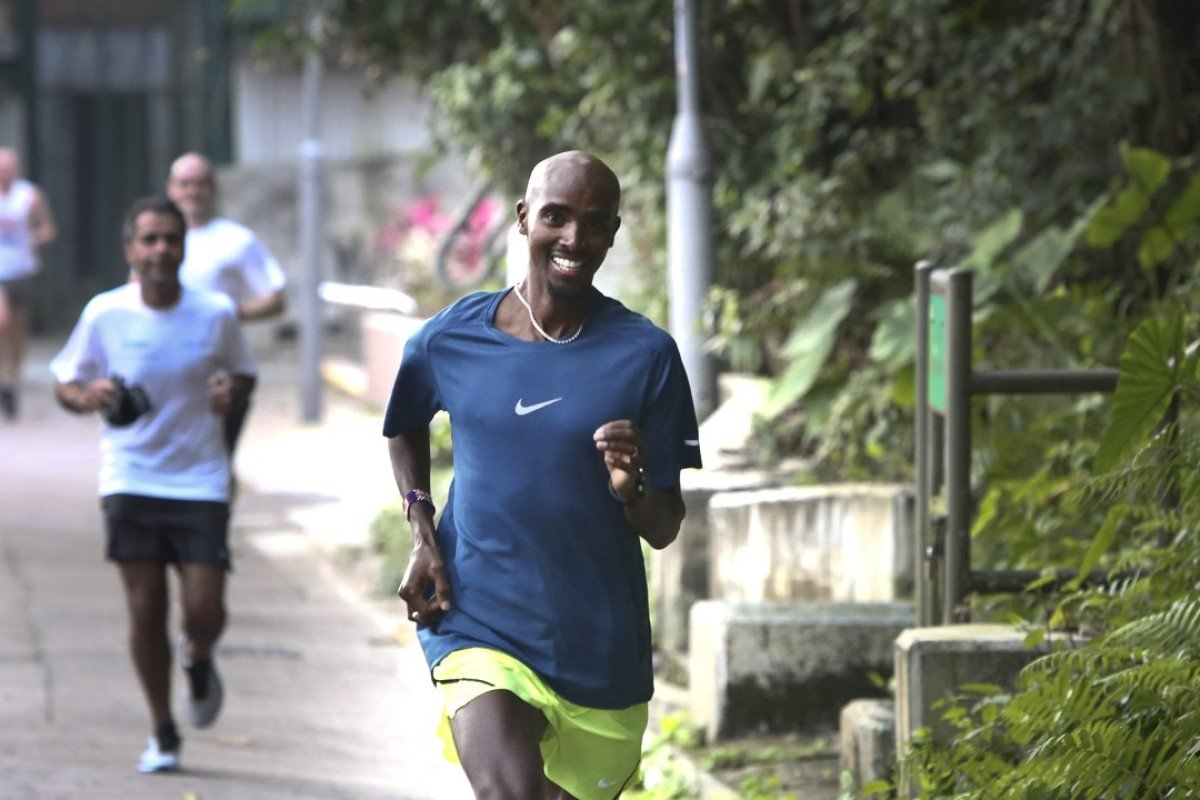 "Sir Mohamed Muktar Jama ""Mo"" Farah jogs with supporters on Bowen Road in 2017. Bowen Road is a great option to keep training in the heat. Photo: Jonathan Wong"