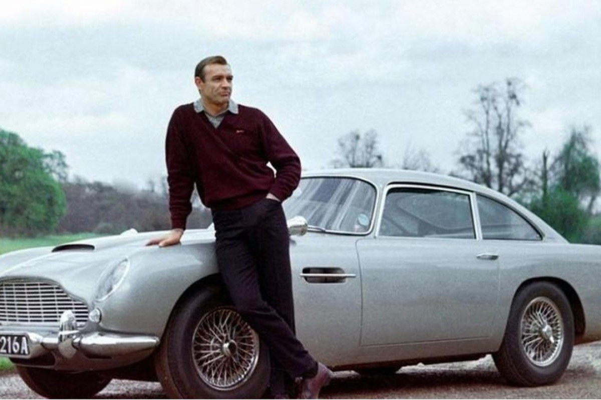 James Bond actor Sean Connery with an Aston Martin DB5, which is ranked among the top 40 film cars of all time in a new poll, but which car was voted number one?