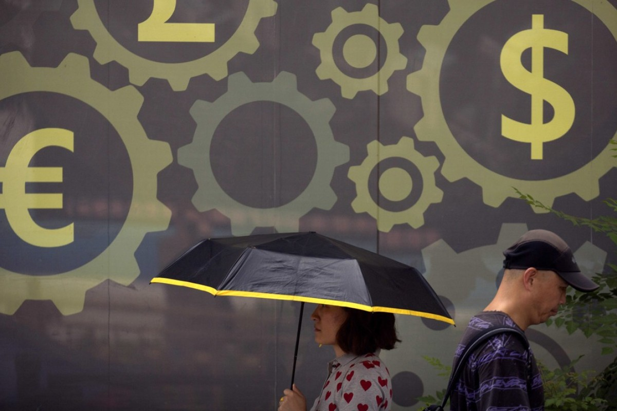 A mural displaying world currency symbols on the outside of a bank in Beijing. The fall of the yuan has been the subject of much concern online. Photo: AP