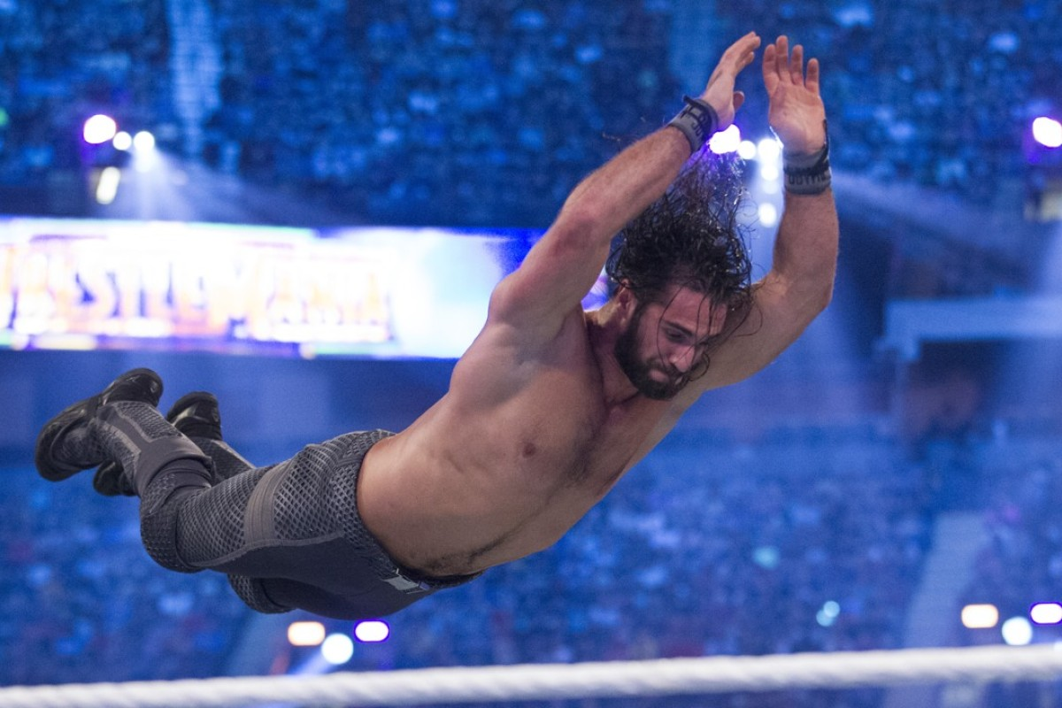 Seth Rollins leaps through the air at WWE's WrestleMania 34 event. Photo: WWE