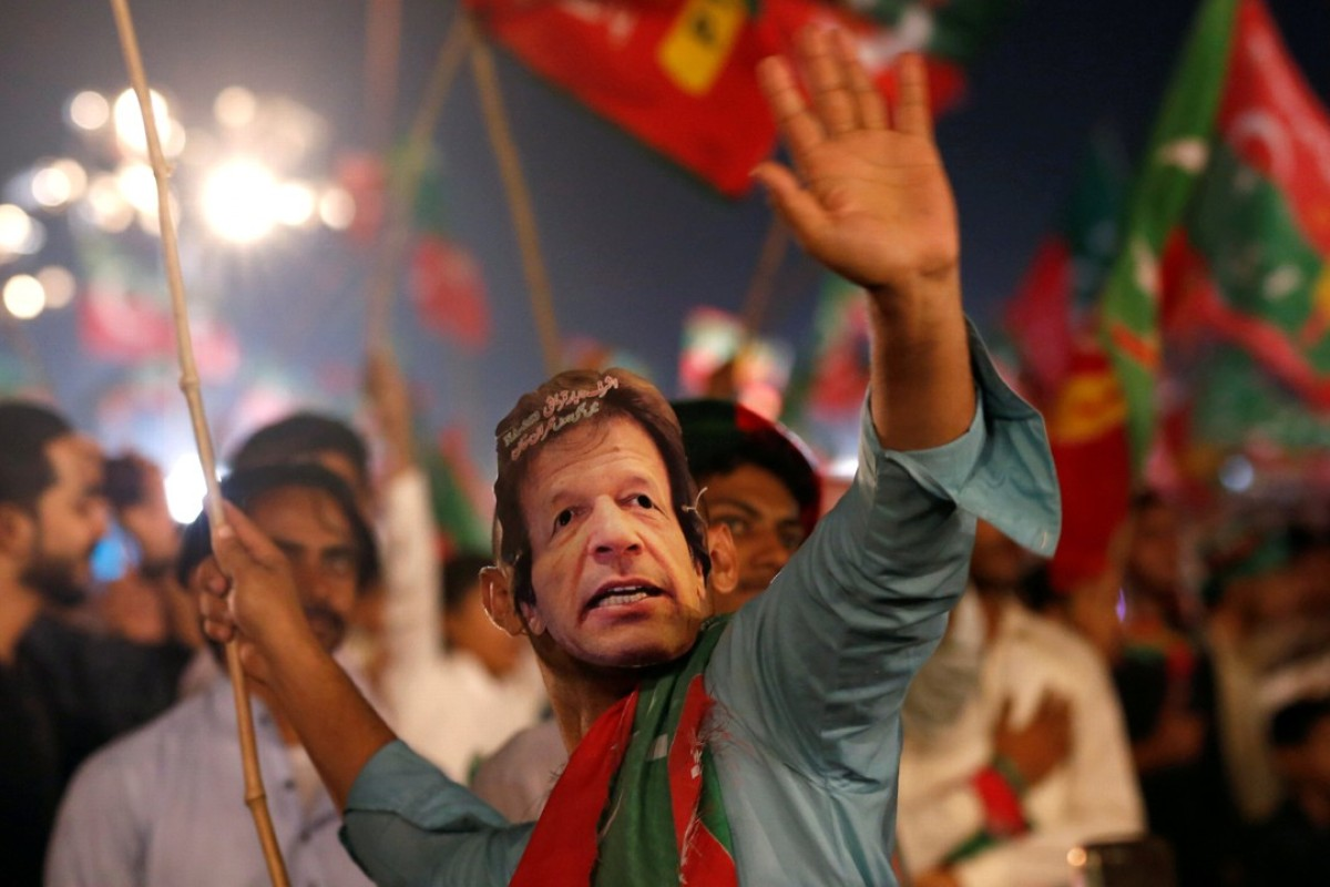 A Tehreek-e-Insaf supporter at a campaign rally in Karachi. Photo: Reuters