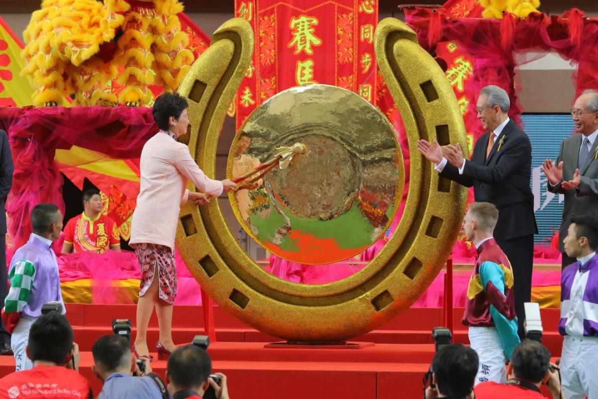 Hong Kong Chief Executive Carrie Lam opens the racing season by striking a gong at Sha Tin Racecourse.