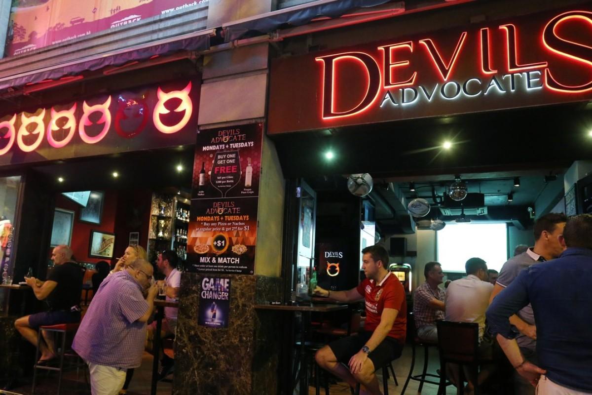 """Demonic fellows"" in a bar in Wan Chai, in Hong Kong. Picture: SCMP / Dickson Lee"