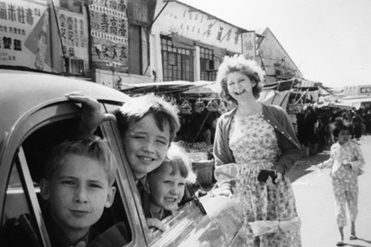 Sarah Driver, then Whitehead, and her brothers in Stanley Market. Picture: Sarah Driver
