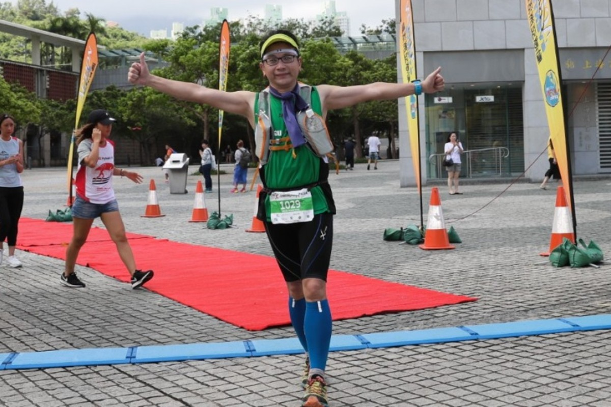 Fred Fung at the finish of the 2017 Lantau 2 Peaks. He might cross the line on his own, but he never runs trail races without his wife. Photos: Action Asia