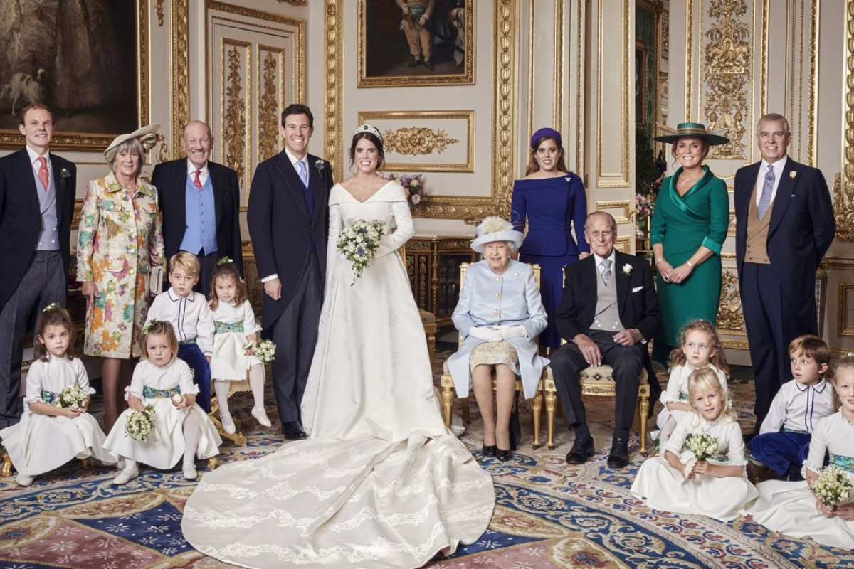 One of the four official wedding photographs released by Buckingham Palace after the wedding of Britain's Princess Eugenie of York and Jack Brooksbank (centre), taken on Friday in the White Drawing Room at Windsor Castle, which also includes (from left, back row) Thomas Brooksbank, the brother of the groom, Nicola and George Brooksbank, the parents of the groom, Eugenie's sister, Princess Beatrice, and her parents Sarah, Duchess of York and Prince Andrew, and (middle row), Prince George and Princess Charlotte, and Queen Elizabeth and Prince Philip. Photo: Alex Bramall/Buckingham Palace/AP