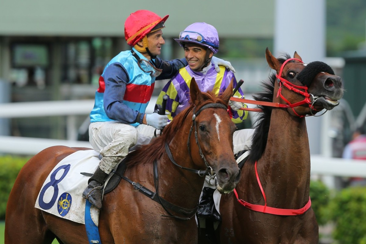 Jockeys Douglas Whyte and Joao Moreira share a moment after the Brazilian's last race in Hong Kong. Photos: Kenneth Chan