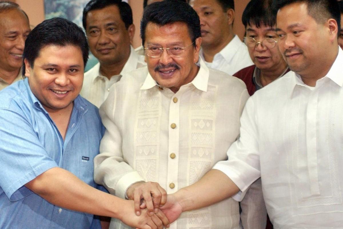Jailed former president Joseph Estrada with his sons Jinggoy Estrada and JV Ejercito. Photo: AFP