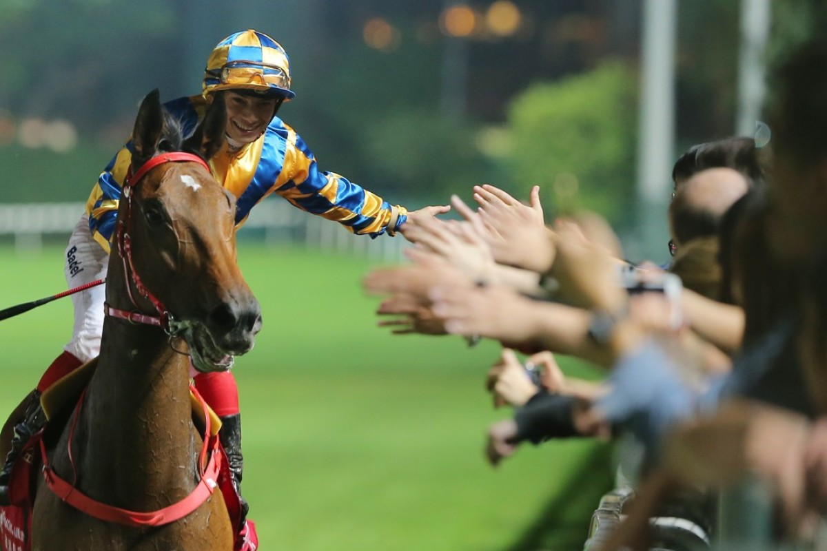 Alexis Badel celebrates a winner with the Happy Valley crowd. Photos: Kenneth Chan