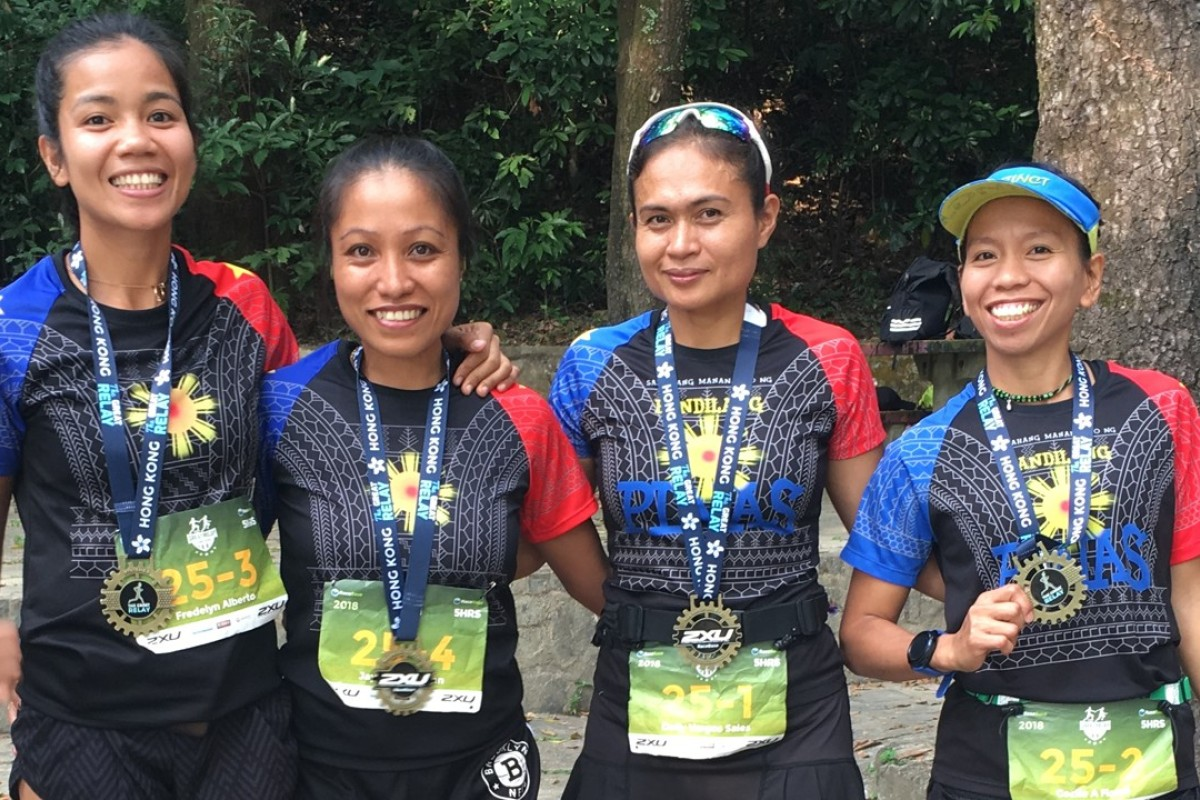 Fredelyn Alberto, Jaybie Pagarigan, Dolly Vargos Sales and Cecile A Flores after winning The Great Relay women's race. Photos: Ben Young
