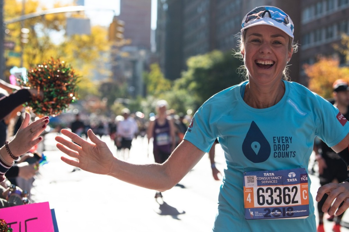 Mina Guli running the New York Marathon, her first of 100 consecutive marathons. Photos: Thirst