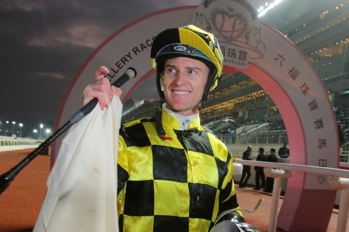Zac Purton does his best to create the figure nine with his fingers to signify his milestone victory. Photos: Kenneth Chan