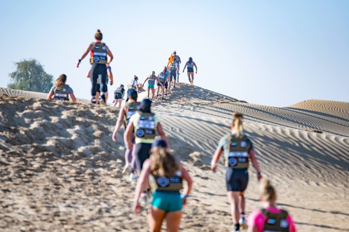 Athletes compete in the '4x4' desert run. Photos: Dubai CrossFit Championship