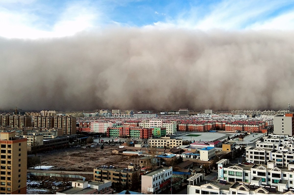 A town in northwest China's Gansu province is engulfed by a sandstorm. Picture: Gansu province website
