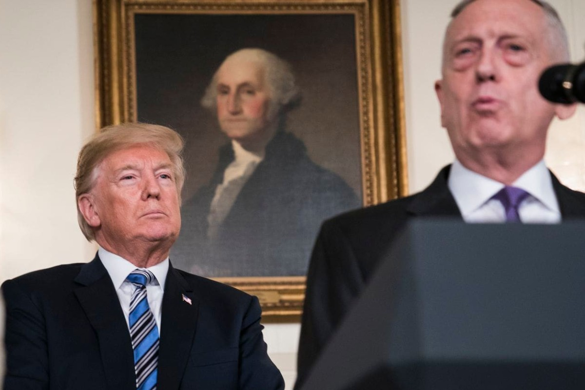 President Donald Trump listens to former defence secretary James Mattis, who quit after the president abruptly announced the withdrawal of troops from Syria. Photo: The Washington Post
