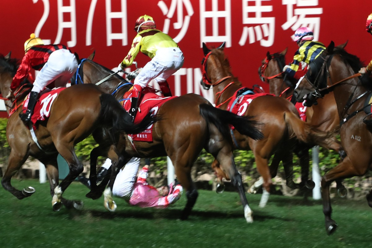 Alexis Badel tumbles after winning the January Cup with Simply Brilliant at Happy Valley on Wednesday night. Photos: Kenneth Chan