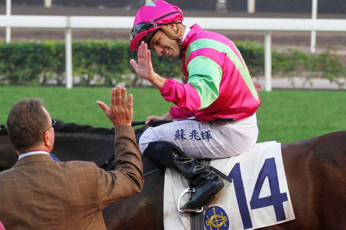 Jockey Silvestre de Sousa and Tony Millard share a high-five after Elusive State's win at Sha Tin on Saturday. Photos: Kenneth Chan