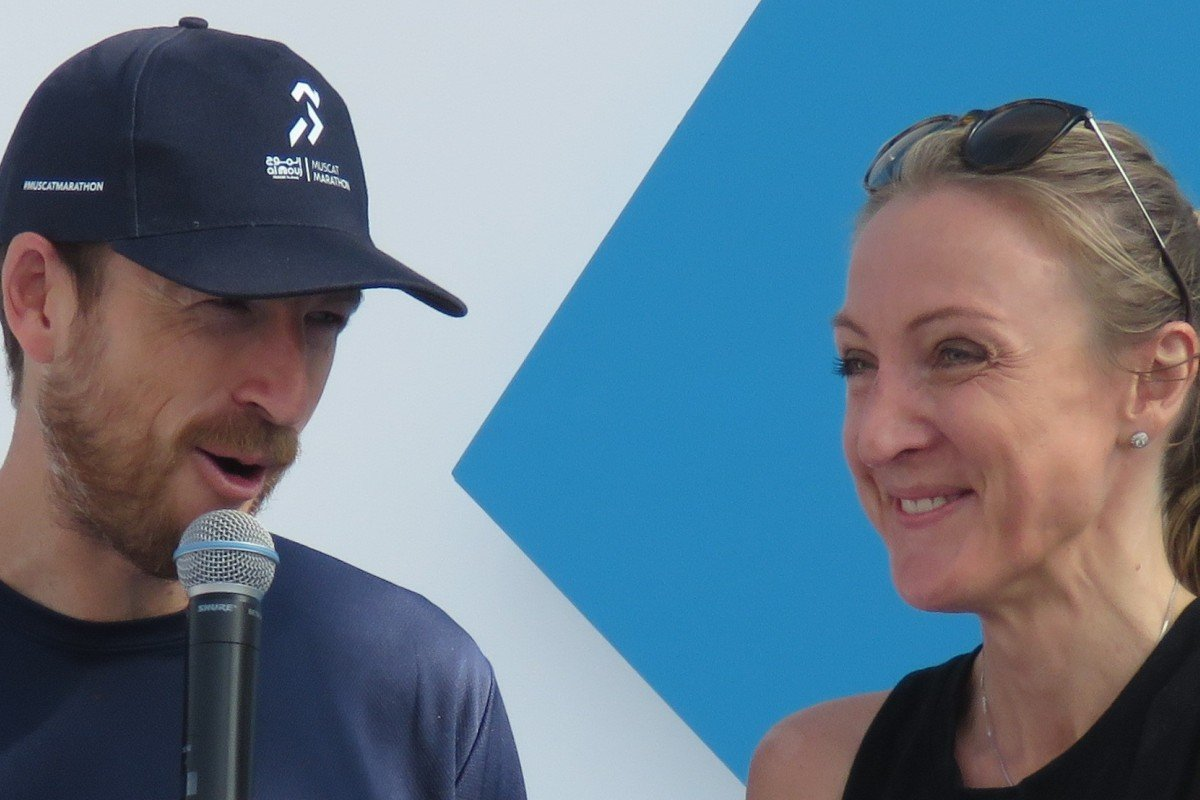 Eoin Flynn interviews Paula Radcliffe at the Muscat Marathon. He quit his desk job and a series of coincidence led him to become the finish line announcer at the UTMB. Photo: Pavel Toropov