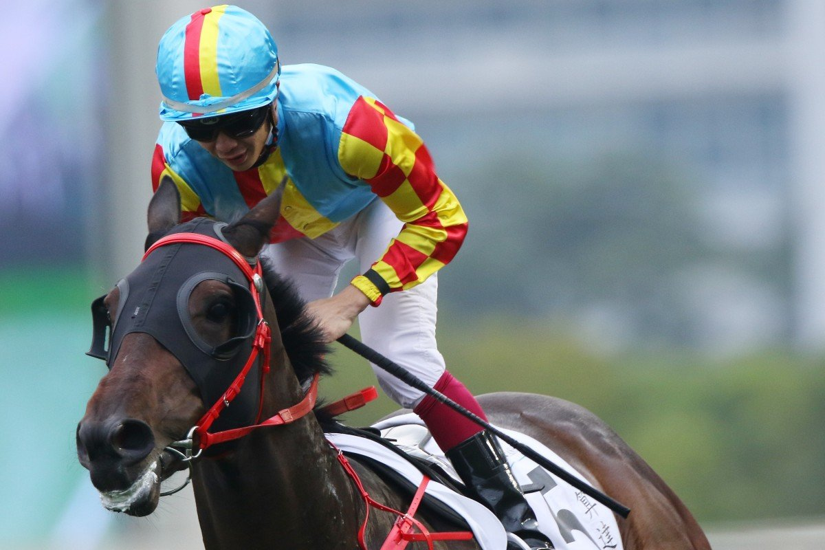 Derek Leung wins the Hong Kong Classic Cup (1,800m) on long-shot Mission Tycoon at Sha Tin on Sunday. Photos: Kenneth Chan