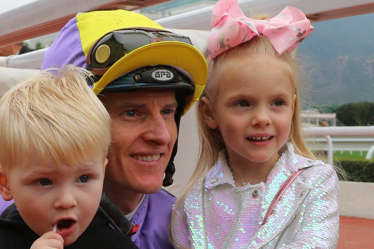 Jockey Zac Purton smiles for the cameras with his two children Cash (left) and Roxy (right) after winning on Time To Celebrate at Sha Tin on Sunday. Photos: Kenneth Chan