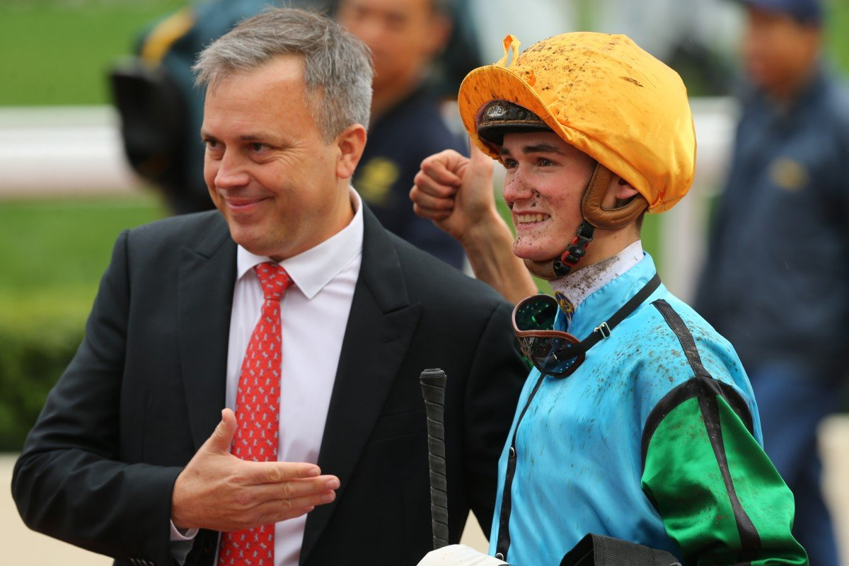 Jockey Regan Bayliss celebrates with trainer Caspar Fownes after his first Hong Kong winner. Photos: Kenneth Chan